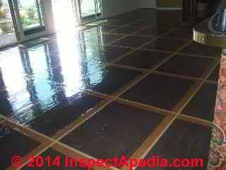 Unidentified floor tiles possibly rubber or vinyl asbestos (C) InspectApedia
