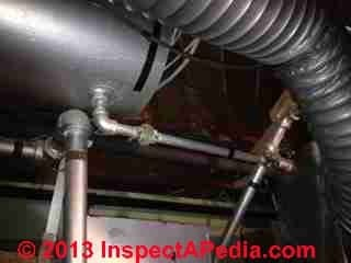 Bladderless expansion tank on gas fired heating  boiler (C) InspectApedia.com HH