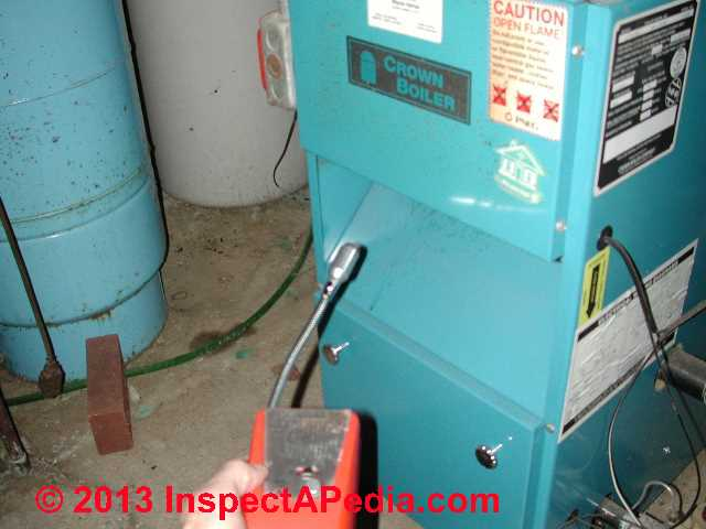 TIF 8800 combustible gas analyzer checking a furnace draft hood for