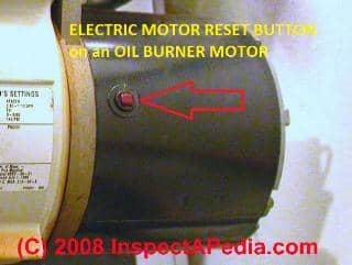 Photograph of the overload reset button on an electric motor