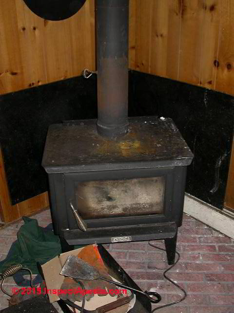 Wood stove showing manual flue damper (C) Daniel Friedman - Wood Stoves Wood Burning Stove Installation, Inspection, Repair