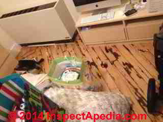 Wood floor with apparent water and rot and mold damage - site of complaint of maple syrup sweet odor complaint (C) InspectApedia H.G.
