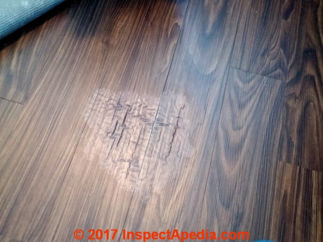 Water Or Solvent Damaged Laminate Flooring (C) InspectApedia.com SM
