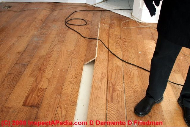 Contemporary snap-together flooring products that resemble wood or ...