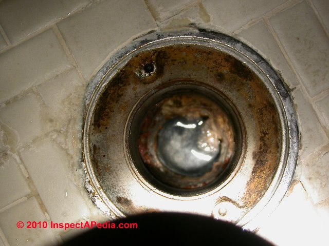 Concrete floor drain trap for Sewer backup smell in house
