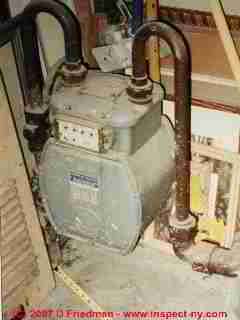Photograph of a gas meter located next to a heating system return air inlet