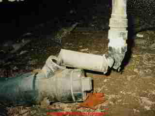 Photograph of sewer line break in a crawl space