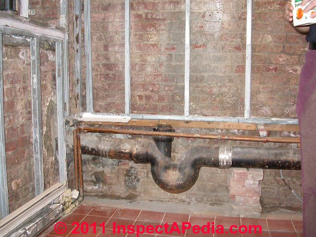 Building plumbing drain cleanouts inspection location for Whole house plumbing trap