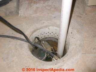 Sump pump pit with no cover and no visible check valve (C) Daniel Friedman