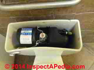 Sloan Flushmate power flush toilet tank & controls (C) Daniel Friedman