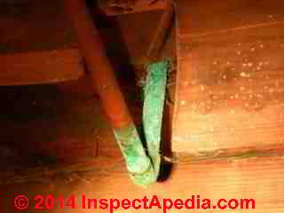 Green corrosion on copper water piping indicates a problem in this photo (C) Daniel Friedman