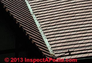Clay tile roof flashing at roof valley (C) Daniel Friedman