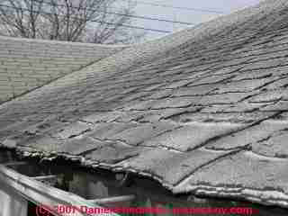 Curled, worn-out organic asphalt roof shingles