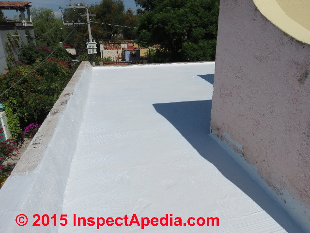 Second coating of Comex brand roof sealant paint on a flat concrete roof in  San Miguel