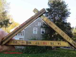 Using a folding carpenters ruler to measure roof slope from the ground (C) Daniel Friedman