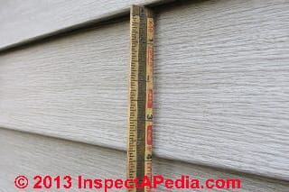 Measuring the width of a siding course (C) Daniel Friedman