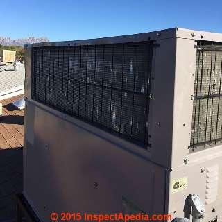 Hail damaged rooftop AC compressor/condenser air handler (C) InspectApedia.com Russell Frazier