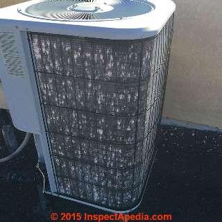 Hail damaged compressor/condenser unit (C) InspectApedia RusselL Frazier