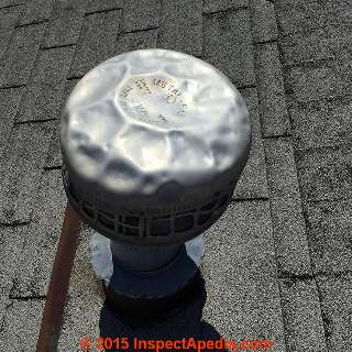 Hail damaged metal roof vent cap (C) InspectApedia.com & Russell Frazier