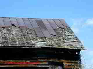 Wood shingle roof, Metal roof-over, worn out (C) Daniel Friedman