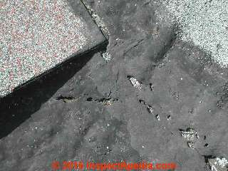 Roof flashing cement failure (C) Daniel Friedman
