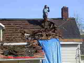 Roof tear off exposes felt underlayment (C) Daniel Friedman