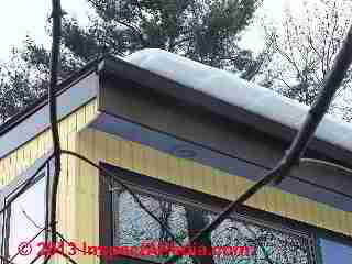 Snow sliding off of a metal roof (C) 2013 Daniel Friedman