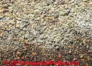 White stain material found on asphalt shingles (C) InspectApedia - & JM