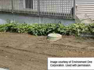 Environment One Sewage Pump Installed - exterior view (C) InspectApedia.com Environment One Corp