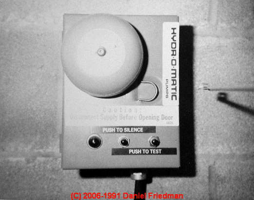 Photo Of A Common Sewage Ejector Pump Alarm Installed In A Basement