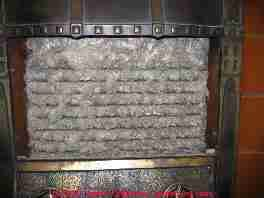 Photograph of a pre-1900 gas fireplace containing asbestos