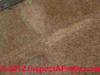 Vinyl asbestos floor tiles in cork tile pattern (C) InspectAPedia & GM