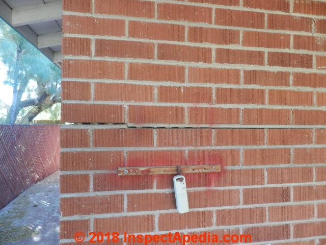 horizontal crack brick wall