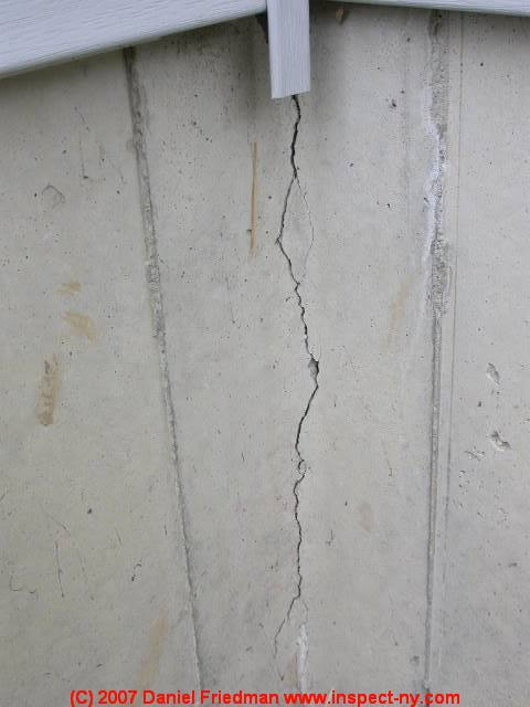 photograph of a substantial settlement crack in poured concrete - Crack In Basement Wall
