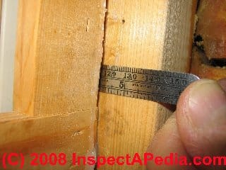 Measuring a leak point in a log wall at a window jamb