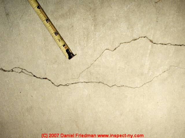 Photograph Of A Basement Floor Slab Crack