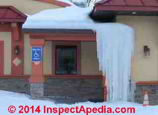 Roof ice dams built a tower of ice from eaves to ground at this Hyde Park NY Restaurant in 2014 © Daniel Friedman