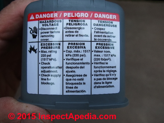 safety and shock warnings on the cover of a square d pumptrol pressure control switch