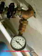 Water pressure test gauge on a hose bibb (C) Daniel Friedman